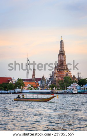 "Bangkok Thailand August 17 - Wat arun with Chao Phraya Express Boat on August 17, 2014 in Bangkok. Wat Arun, ""Temple of Dawn"") is a Buddhist temple in Bangkok Yai district of Bangkok, Thailand. - stock photo"