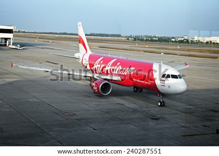BANGKOK, THAILAND - CIRCA JAN 2014: Airliner Air-Asia Airbus A320 at Bangkok airport - stock photo