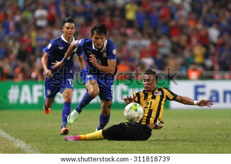 BANGKOK THAILAND DEC17:Adisak Kraisorn of Thailand in action during the AFF Suzuki Cup 2014 Match between Thailand and Malaysia at Rajamangala Stadium on December 17,2014 in Thailand.