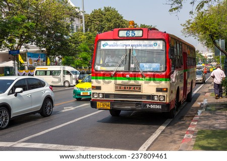 BANGKOK,THAILAND DEC 12: Bus number 65 stopping Opposite Thammasat University, on DECEMBER 12, 2014 in Bangkok, Thailand. - stock photo