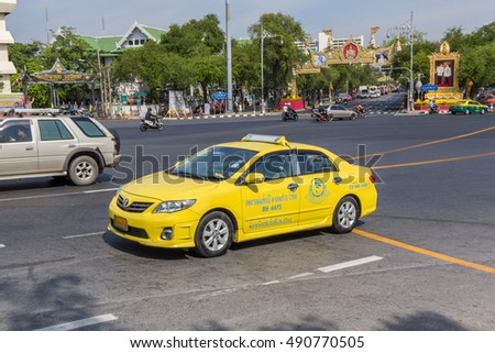 BANGKOK, THAILAND - DEC 18, 2015 : Colorful Bangkok taxis on the street in Bangkok. Public transport develops rapidly in Bangkok, however traffic congestion is still a problem.