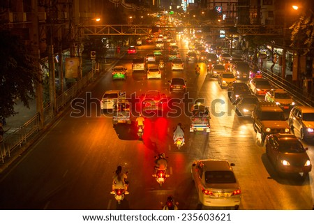 BANGKOK, THAILAND - DEC 5, 2014: Rush hour in city centre. Although Bangkok's canals historically served as a major mode of transport, they have long since been surpassed in importance by land traffic - stock photo