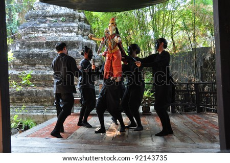 BANGKOK, THAILAND - DEC 18 : The little Thai puppet play requires the synchronized efforts of three puppeteers. They play at Klong Bang Loung on DEC 18, 2011 in Bangkok Thailand