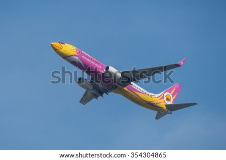 BANGKOK, THAILAND - DECEMBER 20, 2015: A Boeing 737-86N registration number HS-DBS of NOK Air flight DD9514 flying from Don Mueang International Airport (DMK) to Nakhon Phanom Airport (KOP) - stock photo