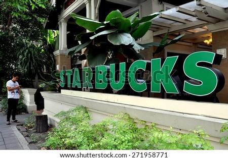 Bangkok, Thailand - December 16, 2011:  An upscale Starbucks Coffee shop on Lang Suan Road - stock photo