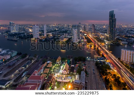 Bangkok, Thailand - December 2, 2014: Bird eye view of Bangkok city along the river during sunset