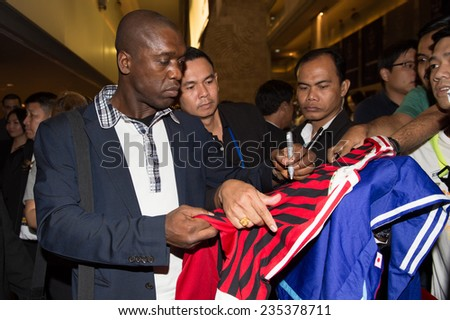 BANGKOK, THAILAND - DECEMBER 03: Clarence Seedorf signs autographs for fans as he arrives in the lead up to the Global Legends Series, at the Swissotel, on Dec 3, 2014 in Bangkok, Thailand - stock photo