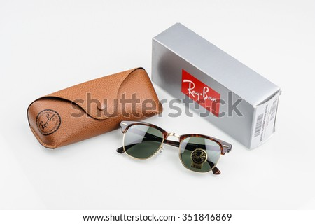 BANGKOK, THAILAND - DECEMBER 16, 2015: Closeup Details of Ray-Ban Club Master RB3016 W0366 -Tortoise. Ray-Ban is a brand of sunglasses and eyeglasses founded in 1937 by Bausch & Lomb. - stock photo