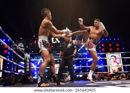 Bangkok, Thailand- December 21, 2014: Competition Finals to the Thai Boxer in World Muay Thai Fight 2014 at ASIATIQUE The Riverfront, Bangkok, Thailand on December 21, 2014. - stock photo