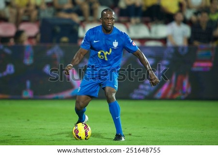 BANGKOK, THAILAND - DECEMBER 05: Dwight Yorke of Team Cannavaro for the ball during the Global Legends Series match, at the SCG Stadium on December 5, 2014 in Bangkok, Thailand. - stock photo