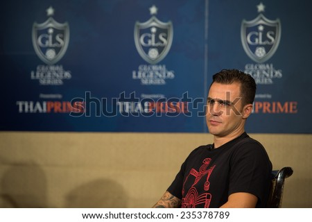 BANGKOK, THAILAND - DECEMBER 03: Fabio Cannavaro  (R)speaks to the media during a press conference in the lead up to the Global Legends Series, at the Swissotel, on Dec3, 2014 in Bangkok, Thailand. - stock photo