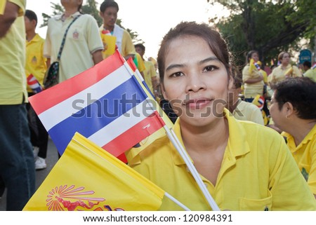 BANGKOK,THAILAND- DECEMBER 5: Hundreds of thousands of Thai people gathered in the streets of Bangkok for a rare public appearance by King Bhumibol Adulyadej on his 85th birthday on December 5,2012