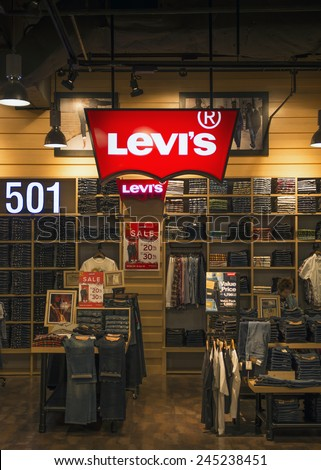 """BANGKOK, THAILAND - DECEMBER 25, 2014: Levi Strauss store in the shopping center """"Robinson"""". Founded in 1853, Levi Strauss is an American clothing company best known for its brand of denim jeans.  - stock photo"""