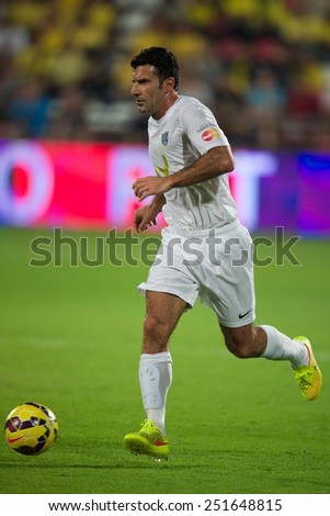 BANGKOK, THAILAND - DECEMBER 05: Luis Figo of Team Figo runs with the ball against Team Cannavaro during the Global Legends Series match, at the SCG Stadium on December 5, 2014 in Bangkok,