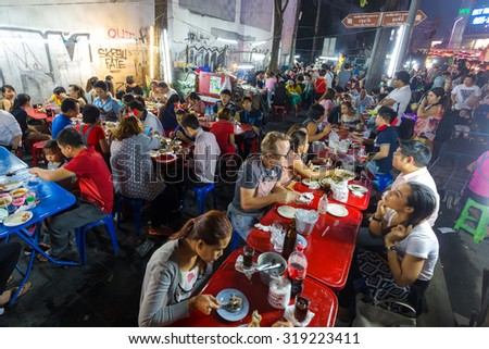 BANGKOK, THAILAND, DECEMBER 25, 2014 : Many customers are eating traditional seafood in a famous street restaurant in the Central World district in Bangkok, Thailand - stock photo