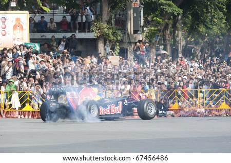 BANGKOK,THAILAND - DECEMBER 18: Mark Webber of Red Bull Racing Team speeding show on Street of Kings, Ratchadamnoen Red Bull Bangkok 2010 ,December 18, 2010 in Bangkok,Thailand