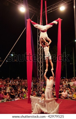 BANGKOK, THAILAND - DECEMBER 13: Members of the Dutch acrobatic dance group Bencha Theater during a performance at the International Street Show on December 13, 2009 in Bangkok, Thailand. - stock photo