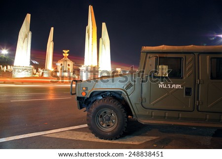 BANGKOK, THAILAND - DECEMBER 06, 2014: Military Truck parking near Democracy monument at night.Soldiers keep the peace around every important area in Bangkok, Thailand. - stock photo