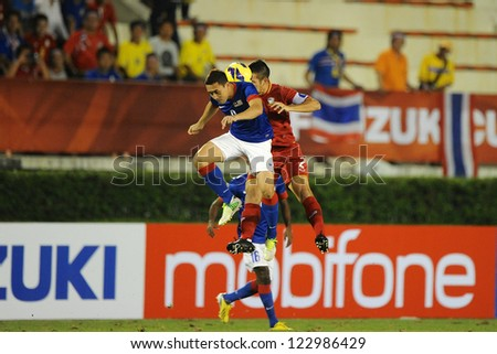 BANGKOK THAILAND-DECEMBER 13:Panupong Wongsa of Thailand (red) in action during the AFF Suzuki Cup between  Malaysia and Thailand at Supachalasai  stadium on Dec 13, 2012 in Bangkok,Thailand.