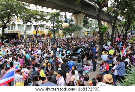 BANGKOK,THAILAND - DECEMBER 20: Parade of Anti-government protesters past Silom road. The protest Against The Amnesty bill in Bangkok, capital of Thailand on 20 December 2013  - stock photo