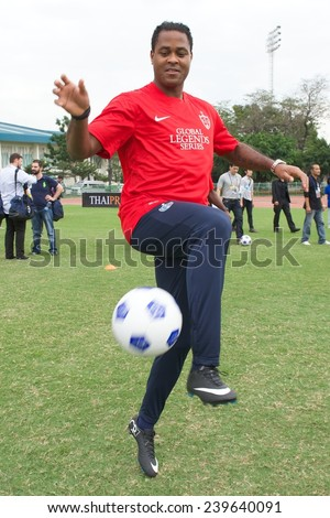 BANGKOK,THAILAND - DECEMBER 04: Patrick Kluivert (red) in action during at the Global Legends Series coaching clinic, at the Thailand Sports Authority, on December 4, 2014 in Bangkok, Thailand. - stock photo