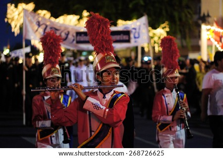 Bangkok, Thailand - 5 December 2014: Soldiers play music at a military parade to celebrate the 87th birthday of His Majesty King Bhumibol Adulyadej at the royal field Sanam Luang adjoining the Grand - stock photo