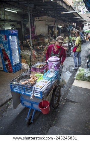 BANGKOK, THAILAND - DECEMBER 25, 2014: Street Photography of Street market in China town. Roll grill for cooking traditional Thai food. - stock photo