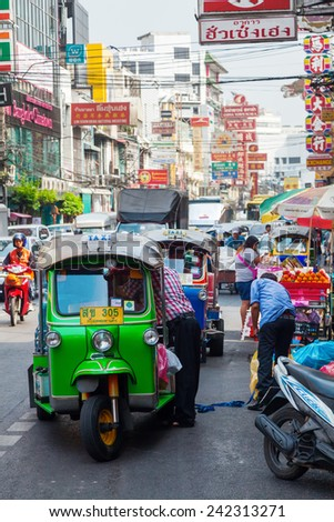 BANGKOK, THAILAND - DECEMBER 12, 2014: street scene in Chinatown with unidentified people. Chinese began settling in the Bangkoks Chinatown circa 1800s, it is a famous tourist attraction