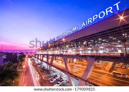 BANGKOK, THAILAND-DECEMBER 02, 2013: Suvarnabhumi Airport at night. This airport is the world's third largest single building airport terminal designed by Helmut Jahn. - stock photo