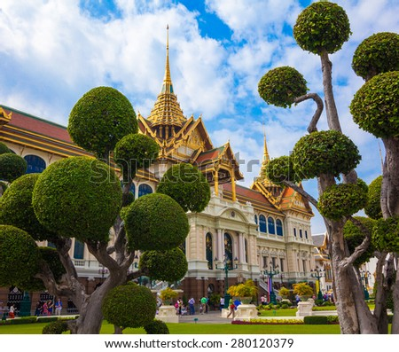 Bangkok, Thailand - DECEMBER 15, 2013: Temples and tourists at Bangkok's Grand Palace. The Grand Palace is made up of various buildings, halls and pavilions. - stock photo