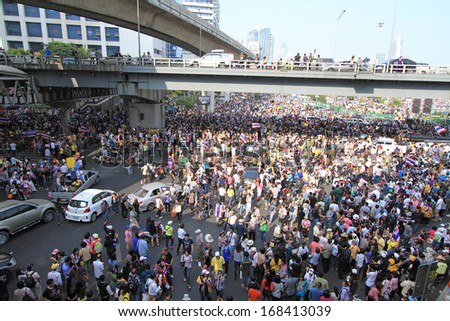 BANGKOK,THAILAND- DECEMBER 22 : Tens of thousands of protesters demonstrators massed peacefully across Bangkok at Silom junction on December 22,2013 in Bangkok,Thailand.