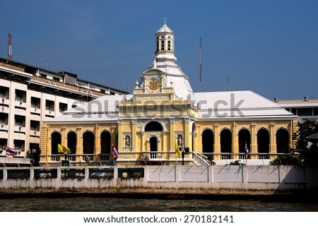 Bangkok, Thailand - December 23, 2011:  19th century Royal Seminary constructed in classical European style overlooks the Chao Praya River * - stock photo