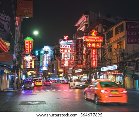Bangkok, Thailand - December 26th 2016: Night Picture of Yaowarat Road which is the Main Street in Bangkok's Chinatown with its Busy Traffic, Neon Signs, Restaurants and Street Food Stalls.
