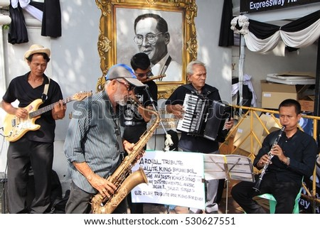 Bangkok, Thailand - December 5, 2016: Thai musicians perform royal songs to pay tribute to their beloved King Bhumibol on his birthday, December 5, 2016, near the Grand Palace in Bangkok, Thailand