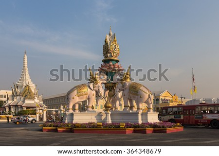 BANGKOK, THAILAND - DECEMBER 27, 2013: The Pink Elephant Statue on the roundabout near Sanam Luang and the Grand Palace in warm, late afternoon light, Bangkok, Thailand. - stock photo