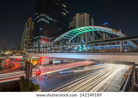 Bangkok,Thailand - December 31,2014 : The traffic light trails  on night at Sathon road, the business centre in Bangkok,Thailand.
