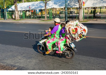 BANGKOK, THAILAND - DECEMBER 10, 2014: the whole family on the move with a motorcycle. In Bangkok motorcycles are most common means of transport - stock photo