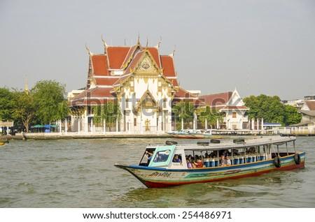 BANGKOK, THAILAND, DECEMBER 26, 2013: Tourists travel by boat on Chao Phraya River - stock photo