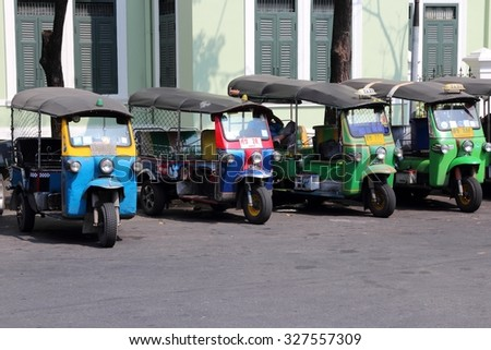 BANGKOK, THAILAND - DECEMBER 7, 2013: Tuk tuk motorbike taxis parked in Bangkok. Bangkok is the biggest city in Thailand with 14 million people living in its urban area.