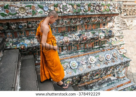 Bangkok, Thailand. December 01, 2012. Unidentified boy monk at the Buddhist temple Wat Arun - stock photo