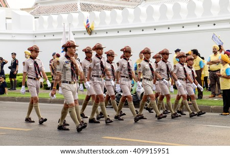 Bangkok, Thailand - December 5, 2015: Unidentified Boy scouts participates in the parade on celebrating of the King Rama 9 birthday at the walls of the Grand Palace, Bangkok, Thailand.  - stock photo