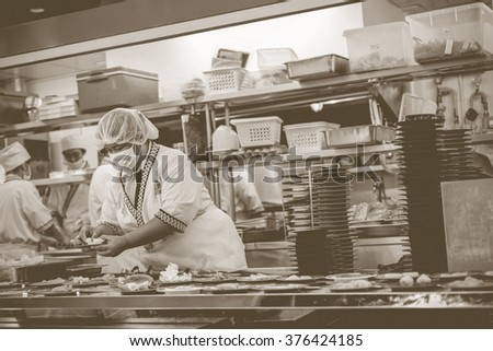 Bangkok, Thailand - December 30, 2015 : Unidentified chefs cooking in the Japan restaurant Kitchen