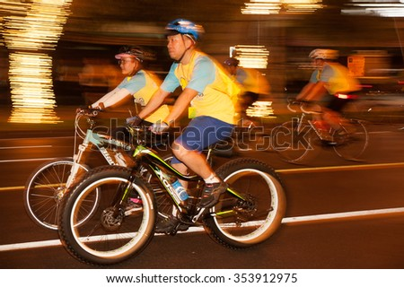 "Bangkok,THAILAND- DECEMBER 11,2015 : Unidentified cyclists  joining an event ""Bike for Dad"" to celebrate the 88th birthday anniversary of His Majesty King Bhumibol Adulyadej  in Bangkok, Thailand."