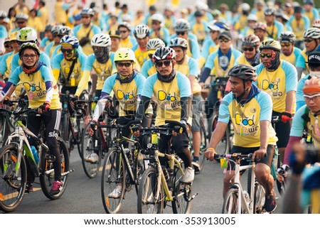 """Bangkok,THAILAND- DECEMBER 11,2015 : Unidentified cyclists  joining an event """"Bike for Dad"""" to celebrate the 88th birthday anniversary of His Majesty King Bhumibol Adulyadej  in Bangkok, Thailand. - stock photo"""
