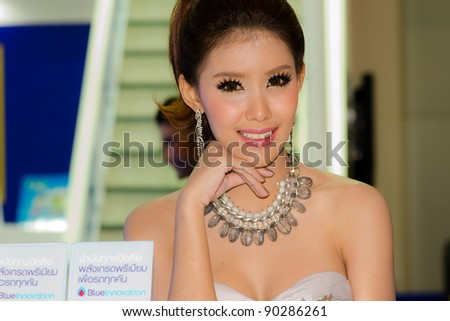 BANGKOK, THAILAND - DECEMBER 6: Unidentified female presenter at PTT booth in THE 28th THAILAND INTERNATIONAL MOTOR EXPO 2011 on December 6, 2011 in Bangkok, Thailand. - stock photo