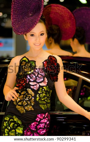 BANGKOK, THAILAND - DECEMBER 6: Unidentified female presenter at Volvo booth in THE 28th THAILAND INTERNATIONAL MOTOR EXPO 2011 on December 6, 2011 in Bangkok, Thailand. - stock photo