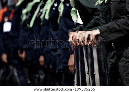 BANGKOK THAILAND-DECEMBER 10 :  Unidentified Woman Riot Police  during a violent anti-government on dec 10, 2013 in Bangkok, Thailand. - stock photo