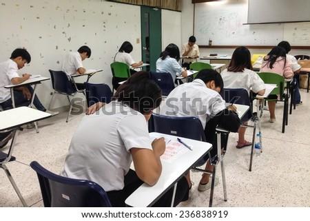 BANGKOK, THAILAND -DECEMBER 11, 2014: University students having mid-term examinations on December 11, 2014 in Bangkok, Thailand - stock photo