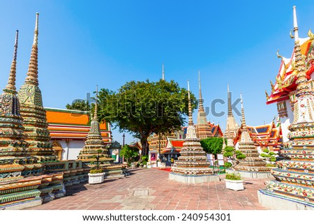 BANGKOK, THAILAND - DECEMBER 10, 2014: Wat Pho known also as the Temple of the Reclining Buddha is a royal temple of the first grade, one of ten such temples in Bangkok and 23 in Thailand - stock photo