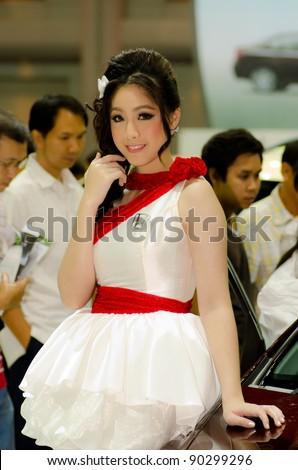 BANGKOK, THAILAND - DESEMBER 6: Unidentified female presenter at Honda booth in THE 28th THAILAND INTERNATIONAL MOTOR EXPO 2011 on Desember 6, 2011 in Bangkok, Thailand. - stock photo
